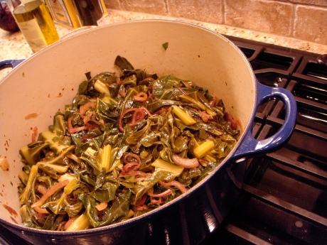 Collard greens with red onions and bacon.