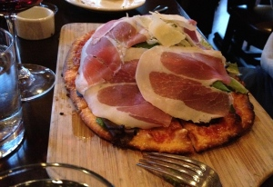 Proscuitto and greens pizza