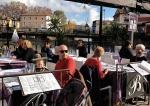 Sidewalk cafe tables at L'Isle-sur-la-Sorgue.