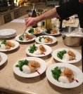 Chef Ginoux plating croquettes.