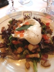 Egg, lardons, crouton. Oh, and greens.