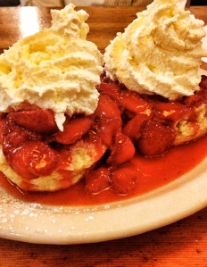Fresh strawberries over biscuits. Summer.
