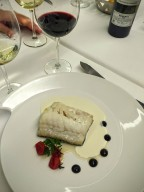 Confit of cod with black and white garlic sauces